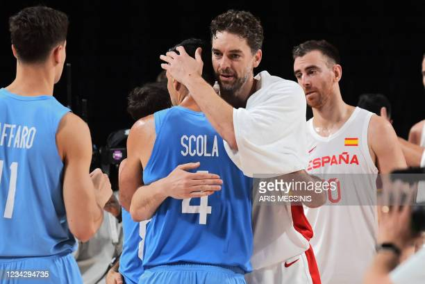 Argentina's Luis Scola and Spain's Pau Gasol Saez embrace at the end of the men's preliminary round group C basketball match between Spain and...