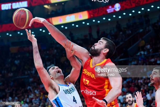 TOPSHOT Argentina's Luis Scola fights for the ball with Spain's Marc Gasol during the Basketball World Cup final game between Argentina and Spain in...
