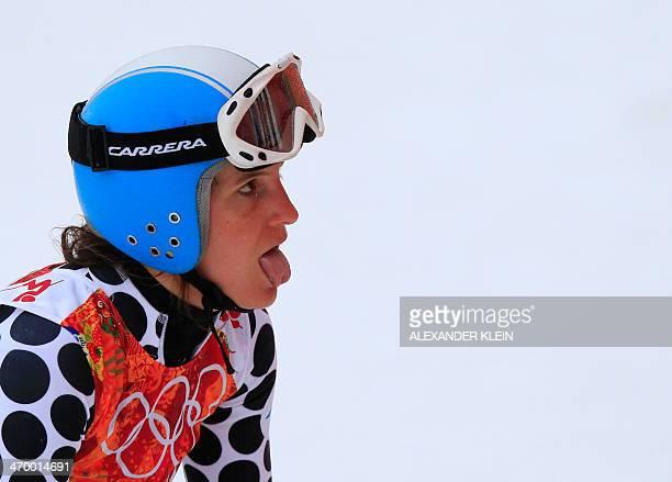 Argentina's Macarena Simari Birkner reacts after the Women's Alpine Skiing Giant Slalom Run 1 at the Rosa Khutor Alpine Center during the Sochi...