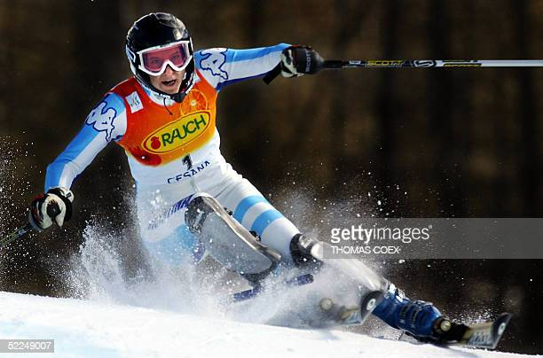 Argentina's Macarena SimariBirkner clears a gate during the women's ski World Cup combined slalom race in San Sicario 27 February 2005 Croatia's...
