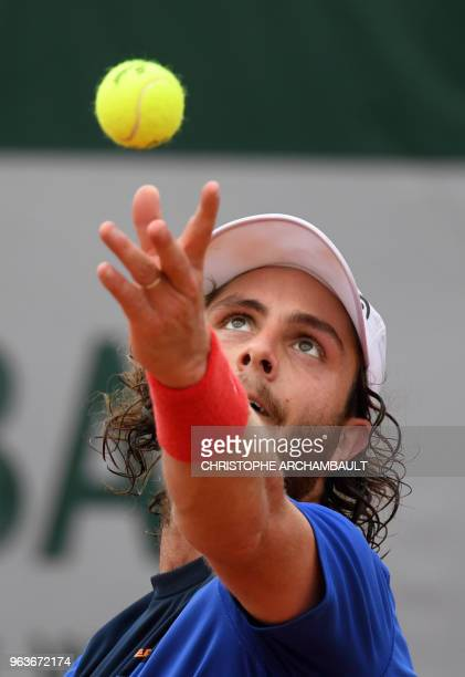 Argentina's Marco Trungelliti serves to Italy's Marco Cecchinato during their men's singles second round match on day four of The Roland Garros 2018...