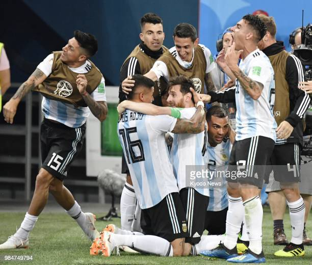 Argentina's Marcos Rojo and Lionel Messi hug each other after their team's 21 win over Nigeria in a World Cup Group D match in St Petersburg Russia...
