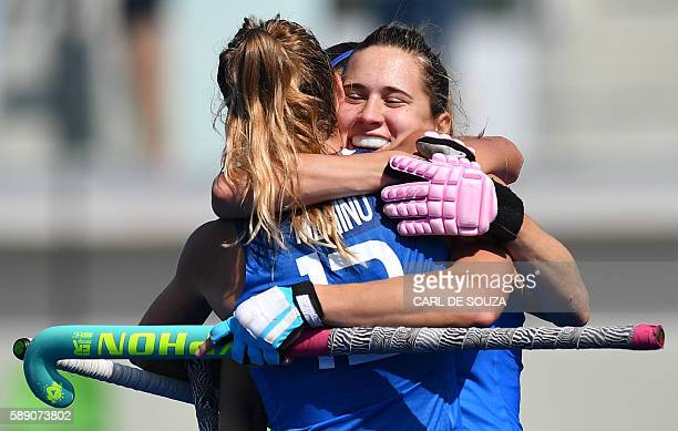 Argentina's Martina Cavallero celebrates scoring with her teammate Delfina Merino during the women's field hockey Argentina vs India match of the Rio...