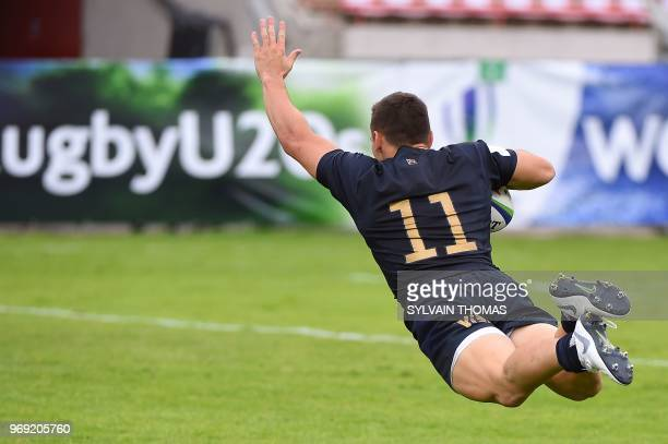 Argentina's Mateo Carreras scores a try during the Rugby Union World Cup U20 championship match Italy vs Argentina at the Mediterranean Stadium in...