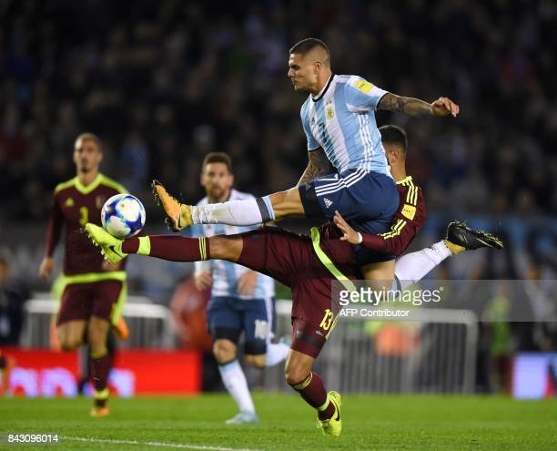 Argentina's Mauro Icardi and Venezuela's Jhon Chancellor vie for the ball during their 2018 World Cup qualifier football match in Buenos Aires on...