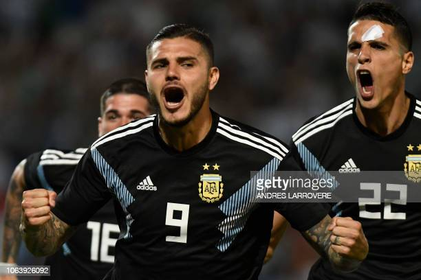 Argentina's Mauro Icardi celebrates after scoring against Mexico during their friendly football match at the Malvinas Argentinas stadium in Mendoza...