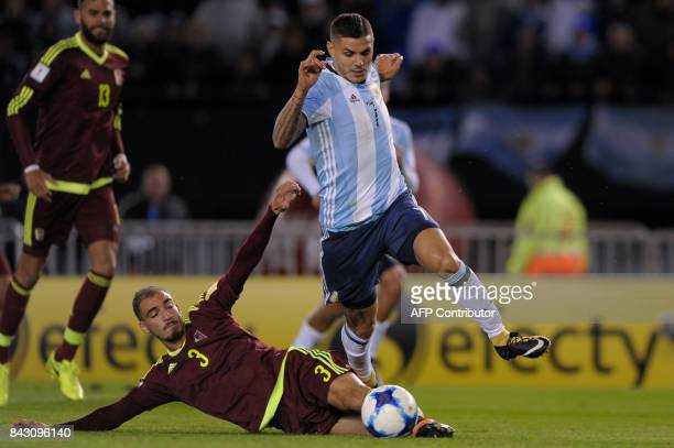 Argentina's Mauro Icardi is marked by Venezuela's Mike Villanueva during their 2018 World Cup qualifier football match in Buenos Aires on September 5...