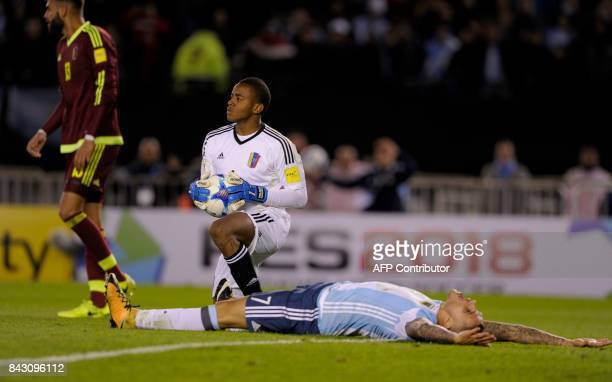 Argentina's Mauro Icardi lies on the ground next to Venezuela's goalkeeper Wuilker Farinez during their 2018 World Cup qualifier football match in...