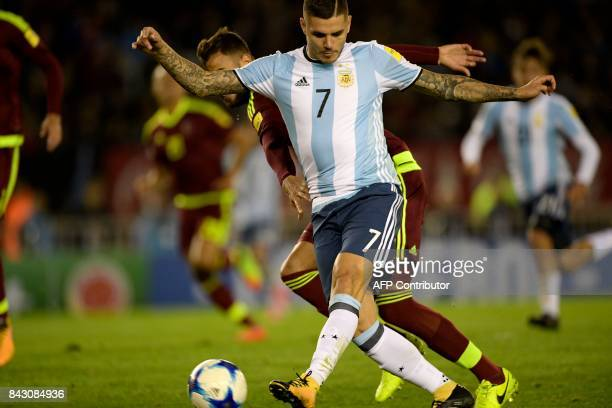 Argentina's Mauro Icardi vies for the ball during their 2018 World Cup football qualifier match against Venezuela in Buenos Aires on September 5 2017...