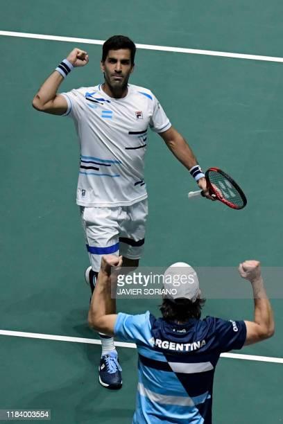 Argentina's Maximo Gonzalez celebrates with Argentina's captain Gaston Gaudio during the doubles quarter-final tennis match against Spain's Marcel...