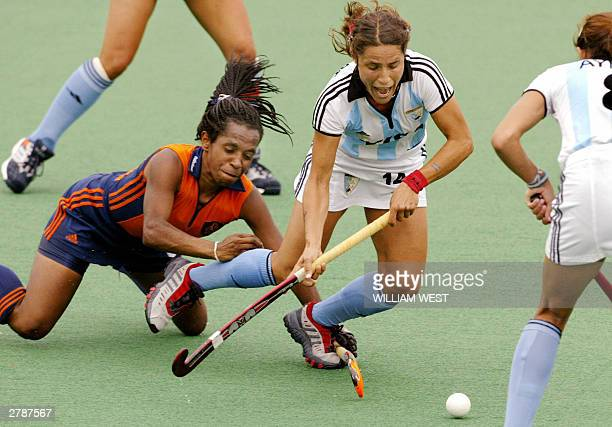Argentina's Mercedes Margalot is brought down in the circle by the Netherland's Maartje Scheepstra to earnt a last minute penalty in their Womens'...
