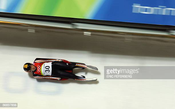 Argentina's Michelle Despain speeds down the track during the second run of the Women's individual luge event at the Turin 2006 Olympic games in...