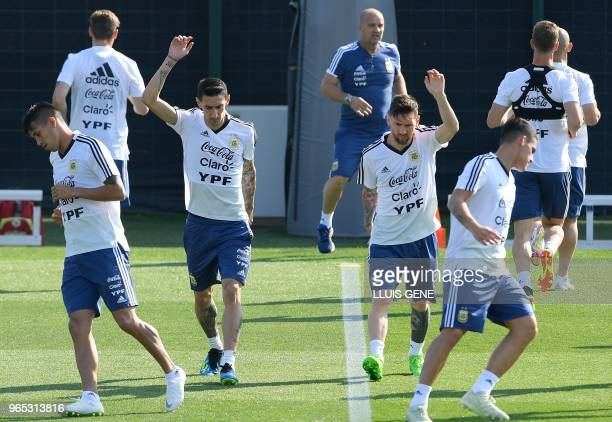 Argentina's midfielder Angel Di Maria and Argentina's forward Lionel Messi attend a training session of Argentina's national football team at the FC...