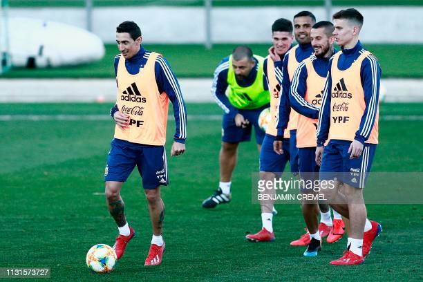 Argentina's midfielder Angel Di Maria and teammates attend a training session at the Real Madrid's training facilities of Valdebebas in Madrid on...