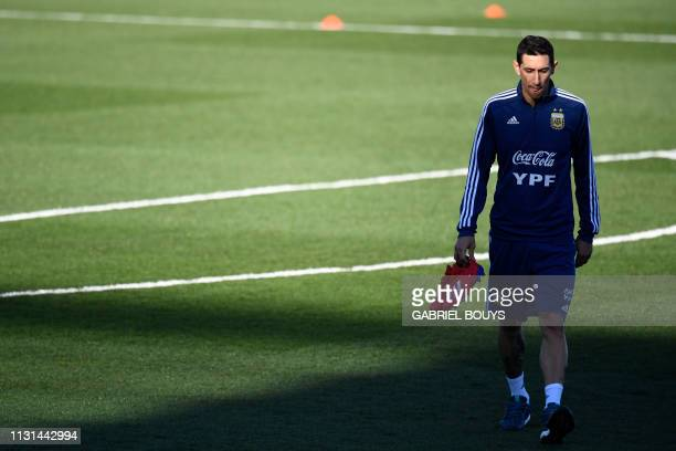 Argentina's midfielder Angel Di Maria arrives for a training session at the Real Madrid's training facilities of Valdebebas in Madrid on March 18...