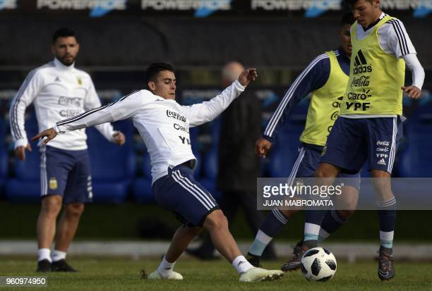 Argentina's midfielder Cristian Pavon vies for the ball with a sparring during a training session in Ezeiza Buenos Aires on May 21 2018 The...