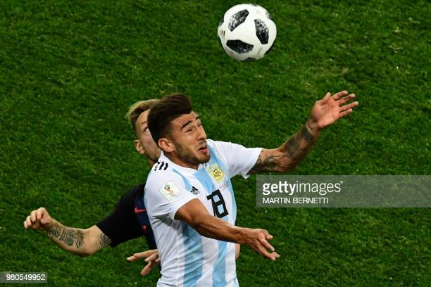 Argentina's midfielder Eduardo Salvio fights for the ball with Croatia's midfielder Ivan Rakitic during the Russia 2018 World Cup Group D football...