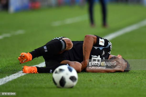 TOPSHOT Argentina's midfielder Eduardo Salvio reacts on the ground during the Russia 2018 World Cup Group D football match between Argentina and...