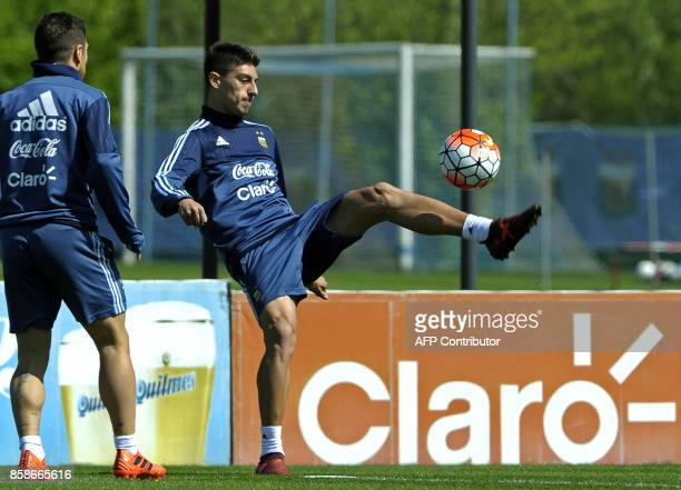 Argentina's midfielder Emiliano Rigoni controls the ball next to forward Lautaro Acosta during a training session in Ezeiza Buenos Aires on October 7...