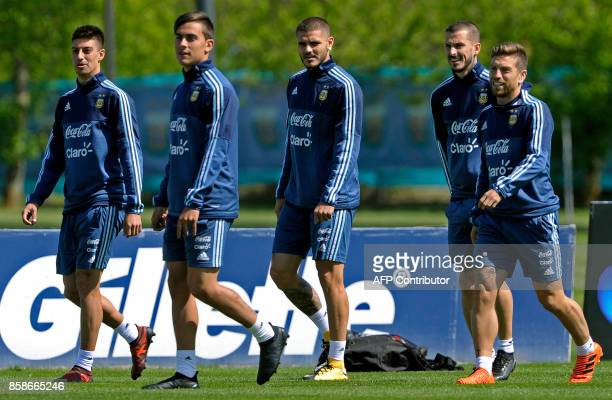 Argentina's midfielder Emiliano Rigoni forwards Paulo Dybala Mauro Icardi Dario Benedetto and midfielder Alejandro Gomez take part in a training...