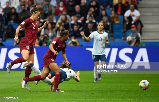Argentina's midfielder Estefania Banini falls as she vies with England's forward Nikita Parris and England's defender Lucy Bronze during the France...