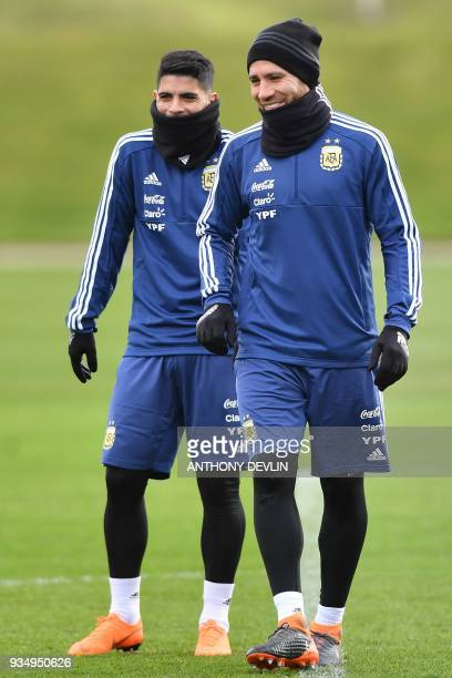 Argentina's midfielder Ever Banega and Argentina's defender Nicolas Otamendi take part in a team training session at the City Academy training...