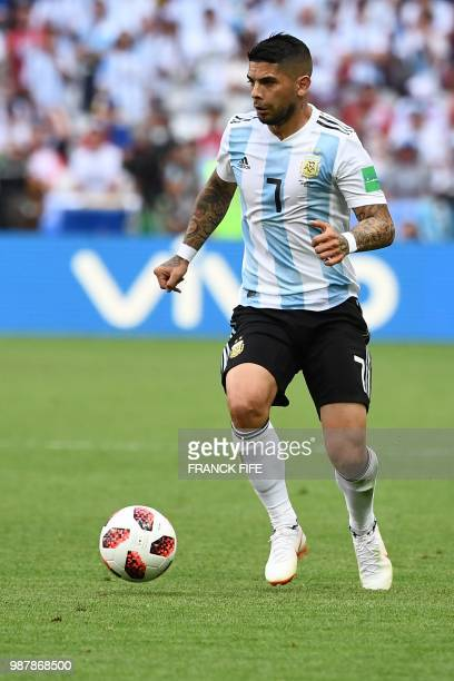 Argentina's midfielder Ever Banega drives the ball during the Russia 2018 World Cup round of 16 football match between France and Argentina at the...