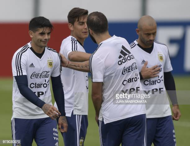 Argentina's midfielder Ever Banega forward Paulo Dybala forward Gonzalo Higuain and midfielder Javier Mascherano take part in a training session at...