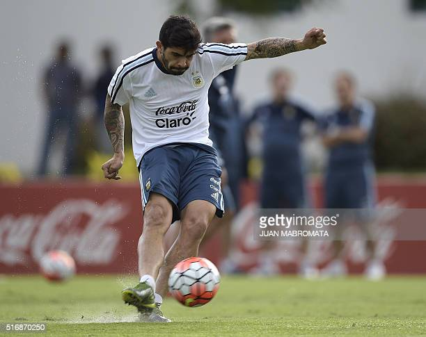 Argentina's midfielder Ever Banega strikes the ball during a training session in Ezeiza Buenos Aires on March 21 2016 ahead of a 2018 FIFA World Cup...
