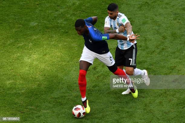 TOPSHOT Argentina's midfielder Ever Banega vies for the ball with France's midfielder Paul Pogba during the Russia 2018 World Cup round of 16...