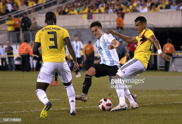 Argentina's midfielder Franco Cervi vies for the ball with Colombia's midfielder Deiver Machado during the international friendly match between...