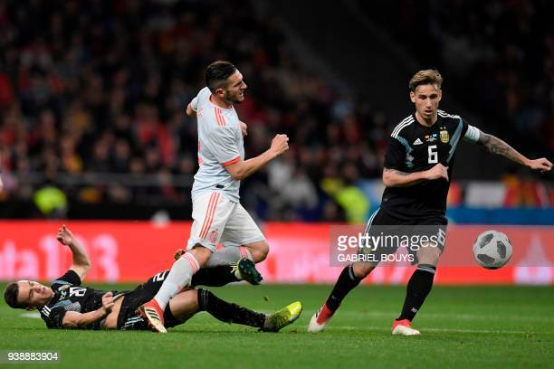 Argentina's midfielder Giovani Lo Celso and Argentina's midfielder Lucas Biglia challenge Spain's midfielder Koke during a friendly football match...