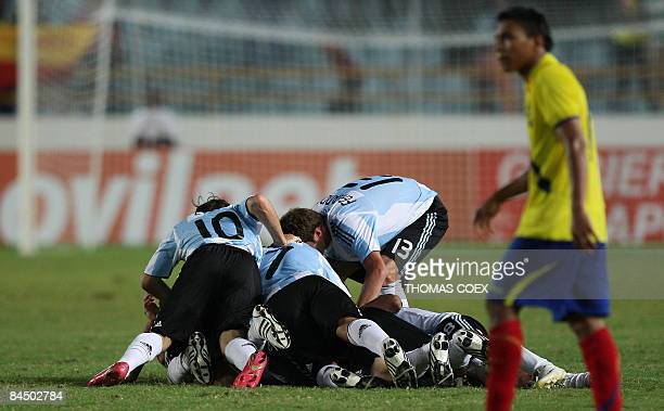 Argentina's midfielder Ivan Bella is congratulated by teammates after scoring against Ecuador during their U20 South American Championship football...