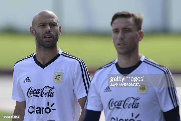 Argentina's midfielder Javier Mascherano and midfielder Lucas Biglia arrive to take part in a training session at the team's base camp in Bronnitsy...