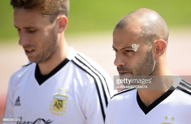 Argentina's midfielder Javier Mascherano and midfielder Lucas Biglia arrive for a training session at the team's base camp in Bronnitsy near Moscow...