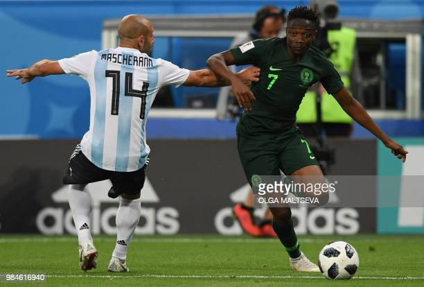 Argentina's midfielder Javier Mascherano and Nigeria's forward Ahmed Musa compete for the ball during the Russia 2018 World Cup Group D football...