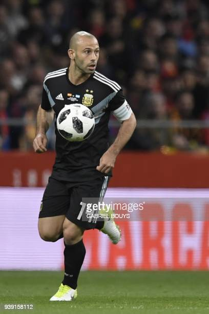 Argentina's midfielder Javier Mascherano controls the ball during a friendly football match between Spain and Argentina at the Wanda Metropolitano...