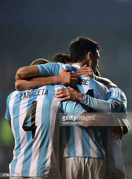 Argentina's midfielder Javier Pastore celebrates with teammates after scoring against Paraguay during their Copa America semifinal football match in...