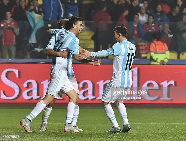 Argentina's midfielder Javier Pastore celebrates with teammates Lionel Messi and Pablo Zabaleta after scoring against Paraguay during their Copa...