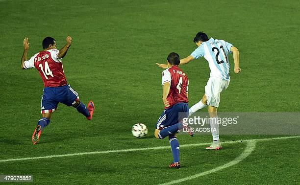 Argentina's midfielder Javier Pastore kicks to score against Paraguay during their Copa America semifinal football match in Concepcion, Chile on June...