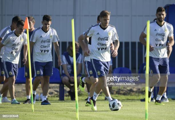 Argentina's midfielder Lucas Biglia drives a ball during a training session at the team's base camp in Bronnitsy near Moscow Russia on June 27 2018...