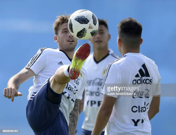 Argentina's midfielder Lucas Biglia practices during a training session at the team's base camp in Bronnitsy on June 29 2018 on the eve of the team's...