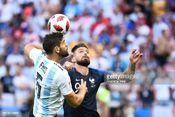 Argentina's midfielder Lucas Biglia vies with France's forward Olivier Giroud during the Russia 2018 World Cup round of 16 football match between...