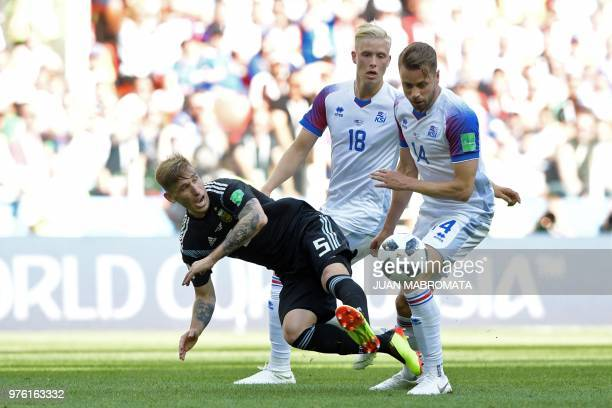 Argentina's midfielder Lucas Biglia vies with Iceland's defender Kari Arnason during the Russia 2018 World Cup Group D football match between...