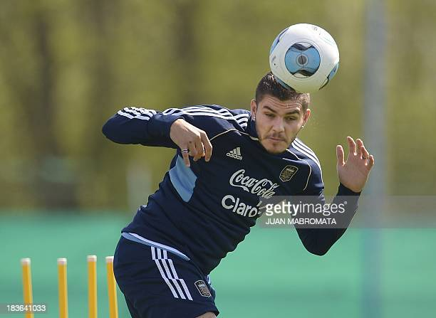 Argentina's midfielder Mauro Icardi heads the ball during a training session in Ezeiza Buenos Aires on October 8 2013 ahead of the Brazil 2014 World...
