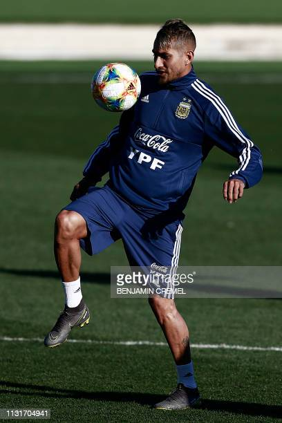 Argentina's midfielder Roberto Pereyra controls a ball during a training session at Real Madrid's training facilities of Valdebebas in Madrid on...