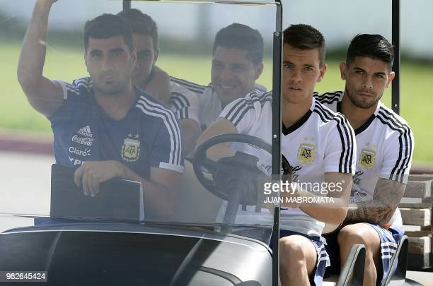 Argentina's midfielders Giovani Lo Celso Ever Banega midfielder Enzo Perez and forward Paulo Dybala and team's press manager Nicolas Novello arrive...