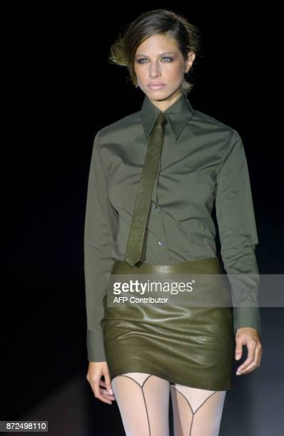 Argentina's model Martina Klein sports an outfit designed by Roberto Torretta 19 February 2001 during presentations of fallwinter Haute Couture...
