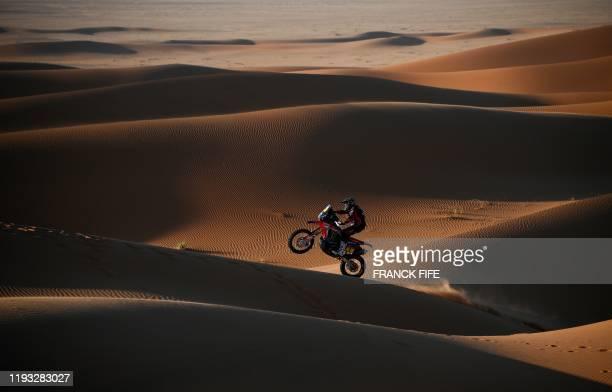 Argentina's motorbike rider Kevin Benavides drives his Honda as he competes in the Stage 7 of the Dakar 2020 between Riyadh and Wadi Al Dawasir,...