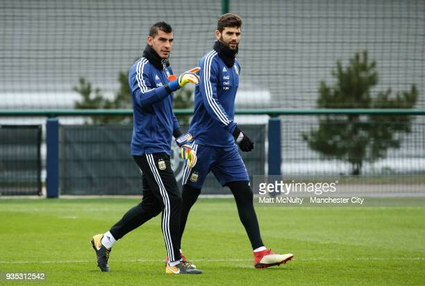 Argentina's Nahuel Guzmn and Federico Fazio during the training session at Manchester City Football Academy on March 20 2018 in Manchester England